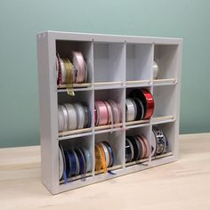 Quickly and easily remove any ribbon spool from the Ribbon Organizer without having to remove others (no dowels to remove and other spools won't unwind when you remove one)!Removing a Ribbon Spool is as easy as removing a book from a bookshelf! With 12 cubbie areas, it's easy to keep like colors arranged together as well. Each cubbie will easily store the SU type Grosgrain ribbon! Great for Sewing Rooms too!