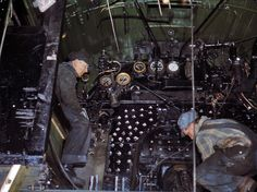Hogger and fireman get ready to apply power to the rails in a locomotive cab 1940.