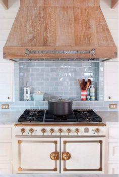 Reclaimed wood hood. Kitchen with reclaimed wood hood. Kitchen hood is made of cerused oak wood.