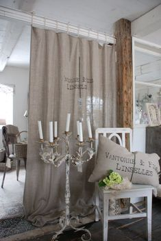easy grain sack curtain! To seperate home school area from Den/play area!