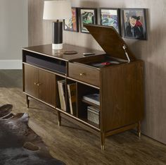 Hooker Furniture is furnishing the vinyl record revival with our new LP Record Player Console. It's a perfect blend of vintage sound and modern function to help music enthusiasts enjoy the richer, more authentic sound of vinyl albums, while still offering wire management for up to a 50-inch TV, games and electronics.