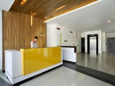reception desk yellow - Google Search
