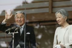 Emperor Akihito waves to well-wishers next to Empress Michiko during the celebration for the New Year on the veranda of the Imperial Palace on 02.01.2015 in Tokyo, Japan