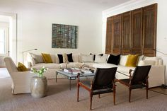 Beautiful salon with white linen sofa & vintage chairs from interior designer Isabel Lopez
