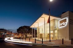 A new contemporary portico at the main entrance reflects the colonnade of Marine Parade's Veronica Sunbay Memorial across the road. - Opus Architecture