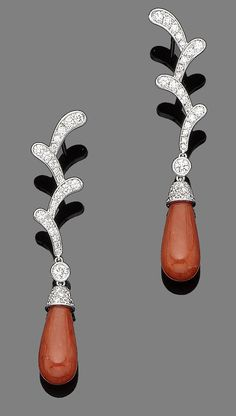 A pair of coral and diamond pendent earrings  Each designed as coral branches, pavé-set with brilliant-cut diamonds, suspending a coral corallium rubrum drop, diamonds approx. 1.45cts total, length 5.7cm