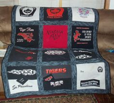 14 Shirts and 4 appliques make a nice sized memory quilt after a father has passed away. Its the perfect size to snuggle on the couch with.