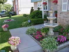 Traditional Landscape/Yard with Classic Tulip 3-Tier Fountain by Sunnydaze Decor - Dark Brown Finish, Raised beds, Fountain