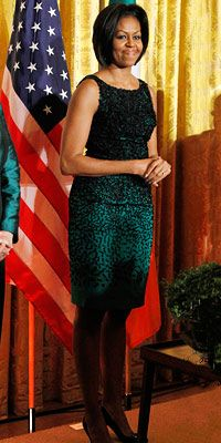First Lady Michelle Obama wearing kelly green dress from Jason Wu.