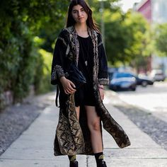 The short shorts act as a nice juxtaposition against the long robe. #fashion #style #dress #beauty #cloth