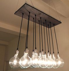Urban Chic Chandelier with reclaimed wood. $525.00, via Etsy.