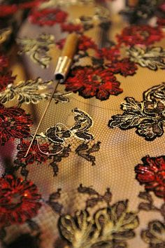 Tambour embroidery on Machine made lace. Oeps...a hole in the lace....dommage!!!