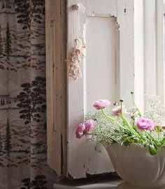 Pale pink, white flowers and dainty foliage against creamy white