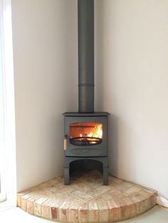 New Pic freestanding Fireplace Hearth Ideas Freestanding Charnwood stove in pewter on log box on brickwork hearth Wood Burner Fireplace, Fireplace Hearth, Fireplace Design, Corner Log Burner, Corner Wood Stove, Log Burner Living Room, Log Burning Stoves, Freestanding Fireplace, Brickwork