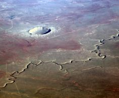 Meteor Crater, also known as Barringer Crater and Canyon Diablo Canyon, in Cococino County, Arizona. Caused around 50,000 years ago by a meteor impact. To the right or west is the intermittent stream of Diablo Canyon. Shot flying west from Newark (EWR) to Los Angeles (LAX).