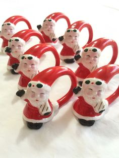 """One Santa has a broken off hand/mitten. They measure about 2""""x 3"""". I will include the broken piece for you to glue on, if you wish. They appear to be made of porcelain or ceramic."""