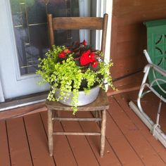 An old chair for a plant stand. I would paint it red to match the door