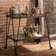 There's something cinematic and wonderful in the simple functionality of the Alera Rustic Industrial Style Antique Black Textured Finish Metal Distressed Ash Wood Mobile Serving Bar Cart.
