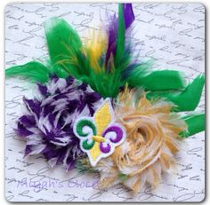 Mardi Gras Feather Hair Clip Mardi Gras parade by MiyahsCloset, $9.99.  Would love to have this for my granddaughter Katie!!