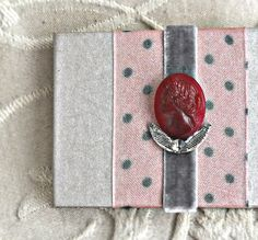 Handmade photo album with a vintage cameo button - by KandiceinWonderland