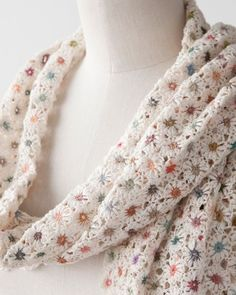 "I happened upon this scarf and I fell in love! I also found some of her other scarves online in a retail shop - they sell for over $300 each. I don't know her whole story but it seems she's doing a good thing.So I decided to try to figure out how to do this and I've come close. I'm still not crazy about the first petal so I'll work on that. Here it is:Tiny Flowers Pattern (about 1"")Size 10 Crochet Thread /  Size 7 steel (1.65 mm) crochet hookCenter: Using a"