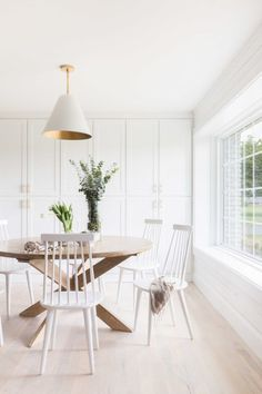 Bright white dining room with built-in cabinet storage