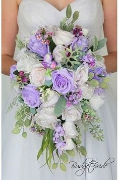 ADVERTISEMENT ADVERTISEMENT Light Purple Lilac and white Cascading Teardrop wedding flower brides bouquet with lilies orchids lambs ear seeded eucalyptus lily of the valley cherry blossoms lots of greenery in these silk artificial wedding theme flowers Light Purple Wedding, Light Purple Flowers, Purple Wedding Bouquets, Lilac Flowers, Wedding Flower Arrangements, Bride Bouquets, Flower Bouquet Wedding, Purple Lilac, Bouquet Flowers