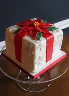 Poinsettia Bow Gift Cake for Christmas. -- SomersetCakes.com