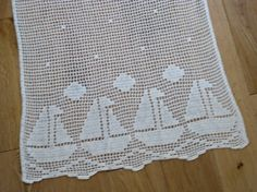 French crocheted curtain panel with boat pattern by Histoires