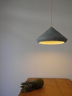"Mizuko Grey, eco friendly pendat lamp made with paper pulp by Crea-Re Studio.  The name Mizuko, means in Japanese the ""daughter of water"". Its minimalistic shape recalls the association with a drop of water, which gently and slowly slides from a leaf and falls again into the water."