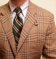 Brown plaid blazer, green striped repp tie, button down shirt, casual Friday