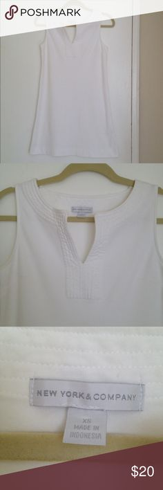 New York and Company White Mini Dress New York and Company White Mini Dress. This dress is very cute, fun and comfortable. No fuss, easy pullover cotton. Great with flats in the summer time. New York & Company Dresses Mini
