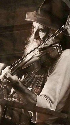 """One lyric of the song was """"He was in a bind 'cos he was way behind..."""". That made me think that the devil was getting older and running out of time, which is why I chose an image of an aged fiddle player."""