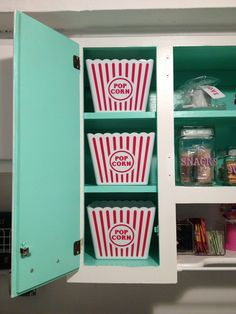 Plastic popcorn containers used for cabinet storage in my whimsical 1950's retro cupcake/candy/treats themed kitchen =) (purchased for $1.00 at Dollar Tree)