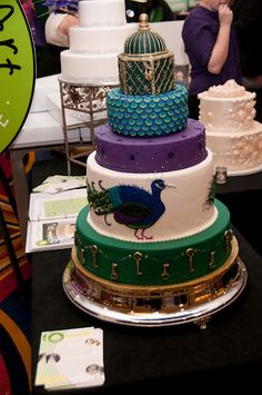 Intricate 5 tier Peacock cake by Edible Art Bakery & Dessert Cafe 4.1.12 Bridal Show RALEIGH - PerfectWeddingGuideNC - Image by Jerry Dillard