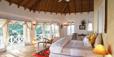 Kamalame Cay: The 21 guest spaces, like this Cottage Suite, have 17-foot vaulted ceilings and an airy vibe.