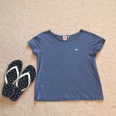Lacoste cropped t shirt in denim blue Size xs cropped t shirt soooo cute with cut off white jean shorts !! Worn once on vacation . Tops Tees - Short Sleeve