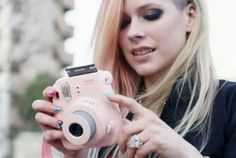 "Avril Lavigne uses an Instax #polaroid #camera in her ""Hello Kitty"" #video. Fujifilm is hoping a wifi-enabled instant film printer will bridge the #Instagram gap. #photography"