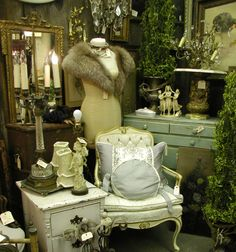french style booth display. reminds moi of my dressing room in our first home at age 21. i designed itcas a boutique, w/ displays. i was in  retail merchandising/marketing at le time. memories.