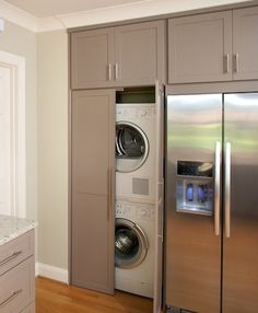 Hidden Laundry Room - Design photos, ideas and inspiration. Amazing gallery of interior design and decorating ideas of Hidden Laundry Room in living rooms, laundry/mudrooms, bathrooms by elite interior designers. Hidden Laundry Rooms, Laundry In Kitchen, Laundry Closet, Laundry Room Organization, Laundry Room Design, Laundry Doors, Laundry Area, Taupe Kitchen Cabinets, Laundry Cabinets