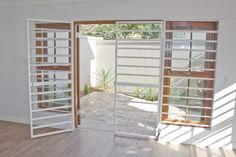 Reliable security gates in Cape Town Home Window Grill Design, Grill Door Design, Balcony Design, Window Security Bars, Security Gates, Safety Gates, House Stairs, Facade House, Burglar Bars