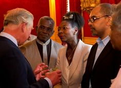 7 May 2013: Prince Charles, The Prince of Wales and Camilla, The Duchess of Cornwall hosted a reception at St James's Palace, London for members of British Caribbean Communities from the worlds of business, politics, sport, entertainment, charity and the media. Here, Prince Charles meets Baroness Floella Benjamin, Rudolf Walker and Tomorrow's Warriors Artistic Director Gary Crosby OBE.