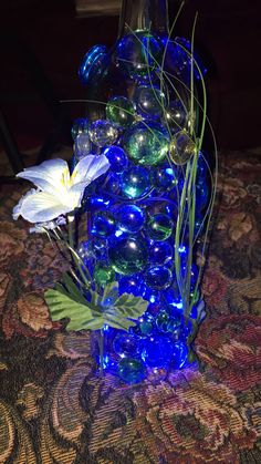 I created this flower glass embellished design on a wine bottle. By JMK