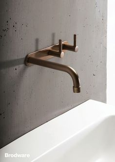 Details we like / Bathroom / Sink / Faucet / Bras / Concrete / at Brodware Yokato, weathered brass