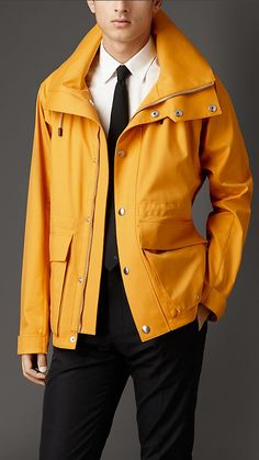 Burberry London Amber Yellow Silk Blend Coat with Packaway Hood - A functional coat crafted in a lightweight blend of cotton, wool and silk.  The protective design features large bellows pockets with concealed press-stud closure, a funnel collar and peaked packaway hood.  Discover the men's outerwear collection at Burberry.com