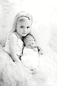 Newborn Baby and Big Sister. Newborn Sibling Pose. B Couture Photography