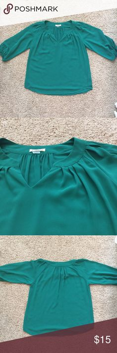 Ezra Emerald Green Top Never Worn • Emerald Green • True to Size • 3/4 Length Sleeves with Elastic on the End • More sheer, but I don't think you would need a cami underneath • 100% Polyester Ezra Tops Blouses