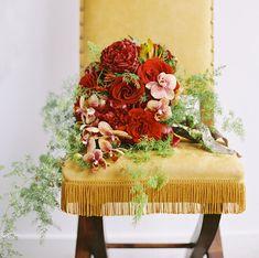 Golden yellow chair + deep red bouquet