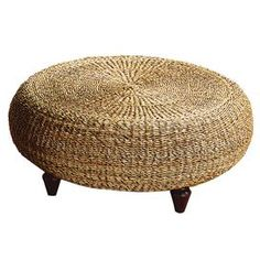 Padma's Plantation Tropical Ottoman - 585/1013 - Joss and Main. Possible copy-cat DIY: Screw round wooden disks to top and bottom of an old tire. Attatch one end of a jute rope to the center point of the top round and begin coiling the rope in a circle, hot gluing as you go. When the sides are reached, continue with the glue and the rope, wrapping it down the sides and onto about the first inch of the bottom round. Screw four stained/painted furniture feet to the bottom disk, and voila…