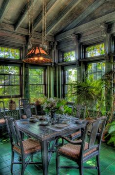 Charming dining room in room with lots of windows/stained glass.